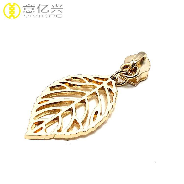 Golden metal zipper puller with custom made zipper pulls for bags